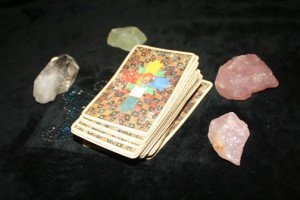 The Thoth Tarot with four crystals