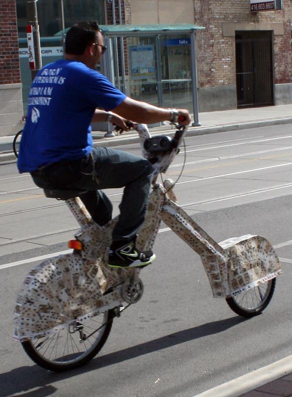 Man on Card-Bike